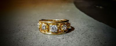 Gold and diamond pinky ring royalty free stock photos