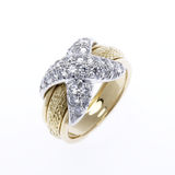 Gold and Diamond ring. Ornate diamond encrusted gold ring on white Royalty Free Stock Photos