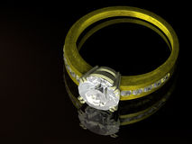 Gold diamond ring. And its reflection royalty free stock photo