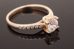 Gold diamond ring on dark background Stock Image