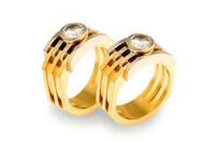 Gold diamond rings. Two gold diamond rings on a white background Stock Photography