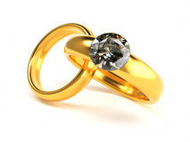 Gold and Diamond Wedding Rings Royalty Free Stock Image