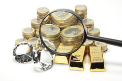 Gold, diamonds, euro coins. Gold, diamonds and euro coins lying on a pile stock images