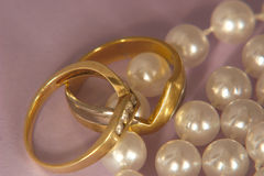 Gold diamonds and pearl. Gold rings and pearls Royalty Free Stock Photos