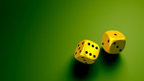 Gold dice at green background wide Royalty Free Stock Photos
