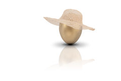 Gold Digger. A golden egg depicting money with a womans hat royalty free stock images