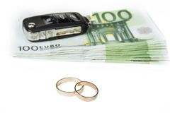 Gold digger concept. Money, car and wedding rings.  royalty free stock photos