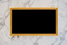 Gold digital movie and picture frame on marble wall Royalty Free Stock Image