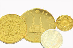 Gold dinar and siver dirham. On white background Stock Photo
