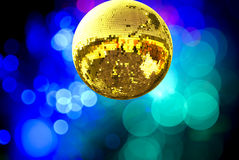 Gold disco ball. With colored lights stock photos