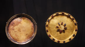 Gold dish & Gold saucer embedded with precious stones. Gold dish and Gold saucer embedded with precious stones in the Ming Dynasty Royalty Free Stock Photos