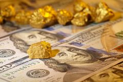 Gold and dollar bills royalty free stock photography