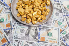 Gold and dollar bills Royalty Free Stock Photo