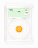 Gold Dollar Coin in Graded Case. Antique gold coin in a collector's case after being graded royalty free stock photo