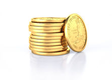 Gold dollar coins stack and one coin recumbent on it. On a white semi reflective surface and white background Royalty Free Stock Photography