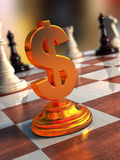 Gold dollar sign. On a chessboard Royalty Free Stock Photos