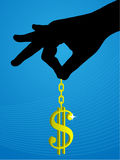 A gold dollar sign hanging by hand Stock Images
