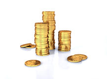 Gold dollar three coins stacks and a few lose. Royalty Free Stock Images