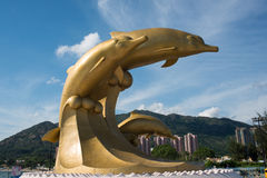 Gold dolphin sculpture Stock Images