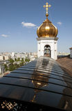 Gold dome and the Cathedral of Christ . Russia. Gold dome and the Cathedral of Christ the Saviour over a belltower and its reflection Stock Images