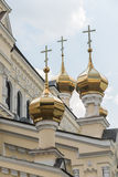 Gold Domes. And cross of an orthodox church in kharkiv Stock Photo