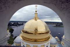 Gold domes of orthodox church with arch. Gold domes of orthodox church with belltower's arch in a monastery of Nil Stolbenskij, Island Stolbnyj, lake Seliger Royalty Free Stock Images