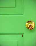 Gold door knob on green Stock Photo