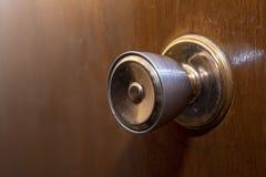 Gold door knob. Wood door, vintage warm feel stock image