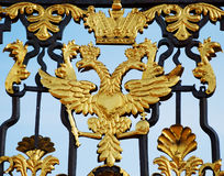 Gold double headed eagle on the gates Royalty Free Stock Images