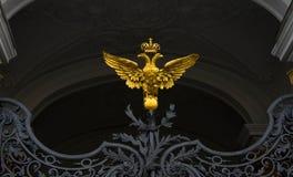 Gold, double-headed eagle on iron gates Royalty Free Stock Image
