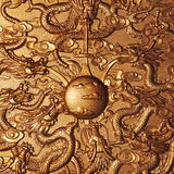 Gold dragon around the gold marble. Background Stock Photos