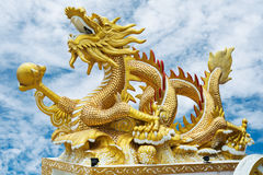 Gold Dragon. With marble in the right foreleg Stock Images