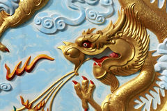 Gold Dragon Painting. And crafting on Thai temple wall Royalty Free Stock Photo