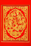 Gold dragon on red background Stock Images