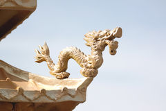 Gold dragon sculpture in the Chinese temple. Stock Image