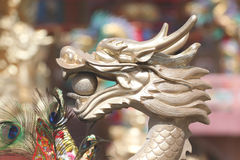 Gold dragon sculpture in the Chinese temple. Stock Photo