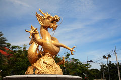 Gold Dragon Sculpture monument Royalty Free Stock Image