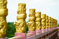 Gold dragon sculptures on the balcony Royalty Free Stock Photo