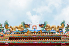 Gold dragon sculptures on the roof Stock Image