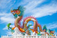 Gold dragon on sky blue. The dragon on sky blue Royalty Free Stock Photos