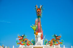 Gold dragon on sky blue. The gold dragon on sky blue Stock Photography