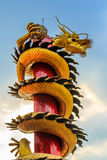Gold dragon slithering into the sky Royalty Free Stock Photography