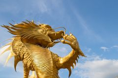 Gold dragon statue beautiful forced beautiful background sky fly Stock Photography