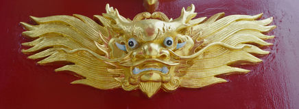 Gold dragon statue. Gold dragon chinese statue style on red wall background Stock Photo