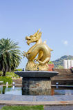 Gold dragon statue at 72nd Anniversary Queen Sirikit Park. Phuket, Thailand Royalty Free Stock Photos