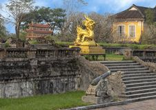 Gold dragon statue on the terrace of the garden of the Forbidden city,Imperial City inside the Citadel, Hue, Vietnam. Pictured is a golden dragon sculpture on royalty free stock photography