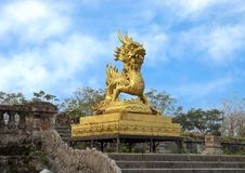 Gold dragon statue on the terrace of the garden of the Forbidden city,Imperial City inside the Citadel, Hue, Vietnam. Pictured is a golden dragon sculpture on stock images