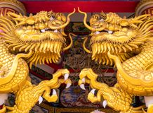 Gold dragon statues in Chinese religious venues royalty free stock photos