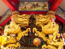 Gold dragon statues in Chinese religious venues royalty free stock images