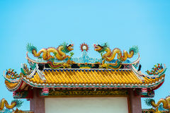 Gold dragons on the shrine roof. Gold dragons located on the shrine roof royalty free stock image
